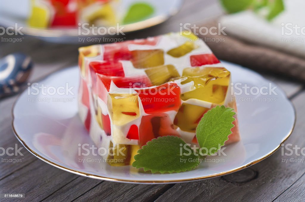 fruit dairy, red and green jelly on a plate. stock photo