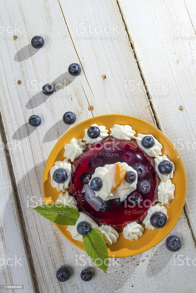 Fruit dessert with cream and fresh mint stock photo