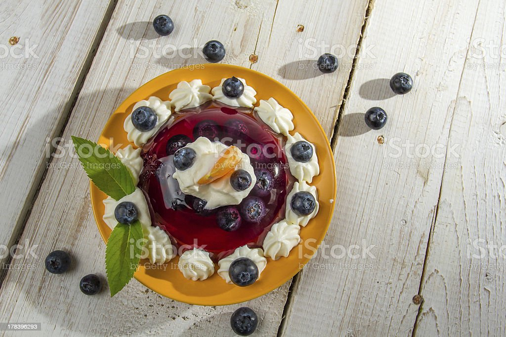 Fruit dessert with cream served on a plate royalty-free stock photo