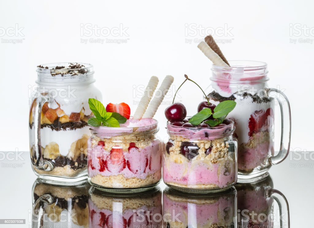 Fruit desserts in a jar with reflection stock photo