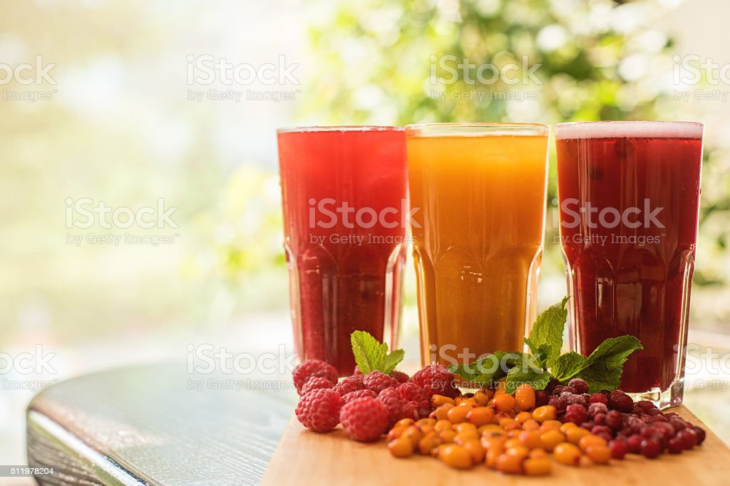 fruit drink with cranberries raspberries and sea buckthorn stock photo