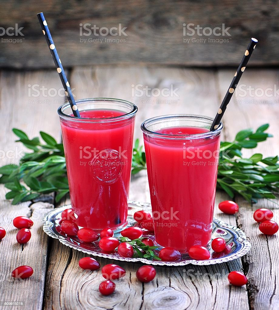 fruit drinks from a cornel on the old wooden background. stock photo