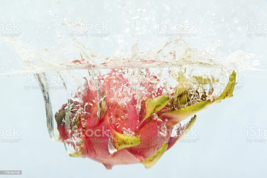Fruit Drop to the water. royalty-free stock photo
