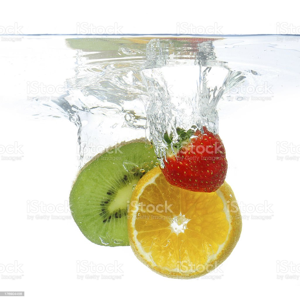 Fruit dropped in the water royalty-free stock photo