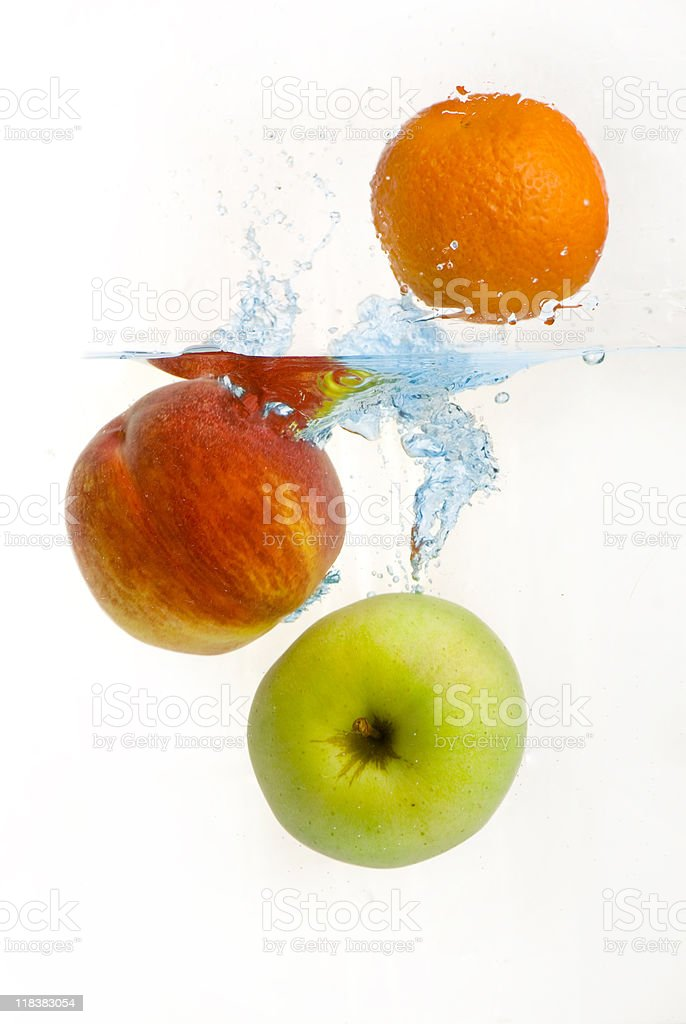 Fruit fall in the water royalty-free stock photo