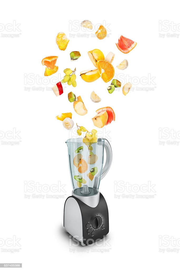 Fruit falling in a juicer stock photo