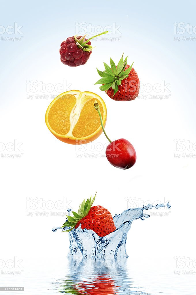 Fruit falling in water royalty-free stock photo