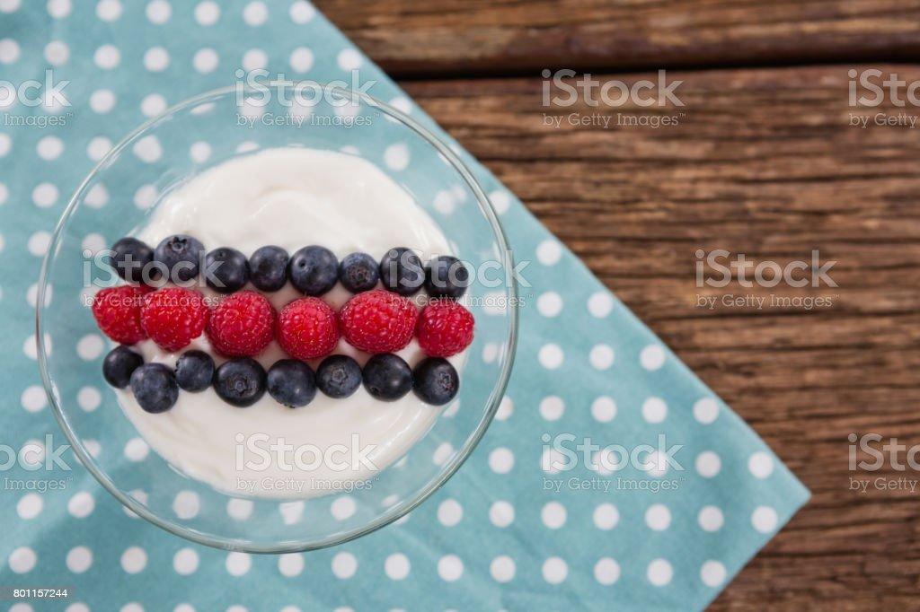 Fruit ice cream on wooden table stock photo