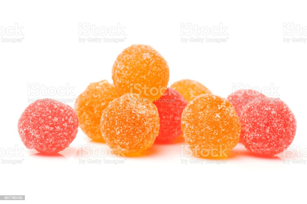 fruit jelly colored balls on a white background stock photo