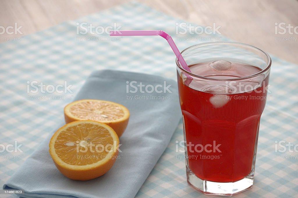 Fruit juice and orange halves stock photo