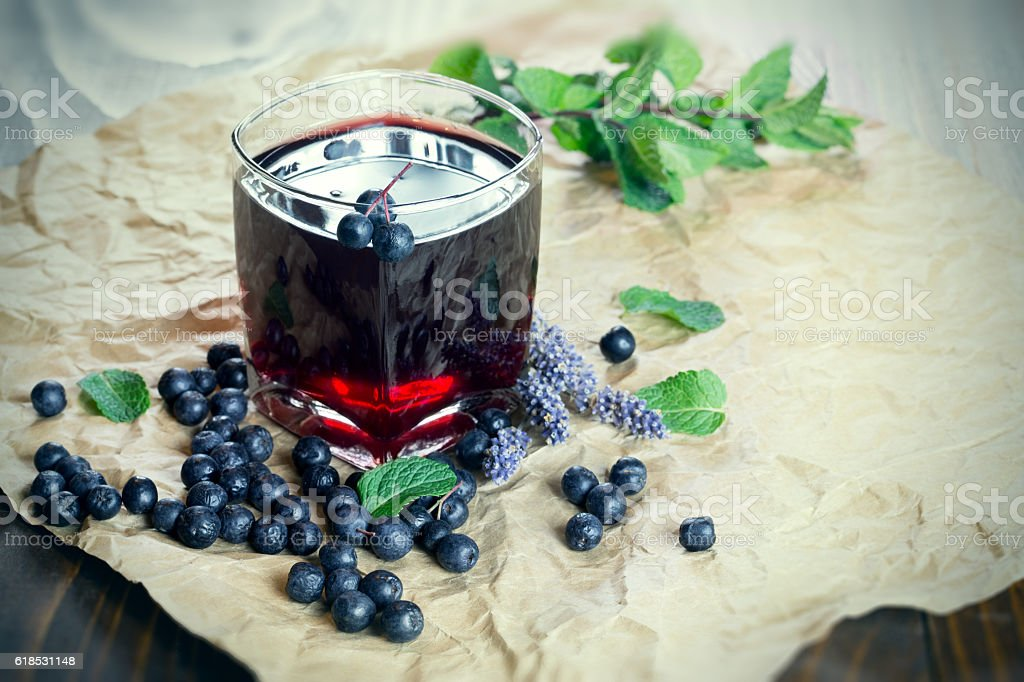 Fruit juice with forest fruit - aronia-berry and blueberry stock photo