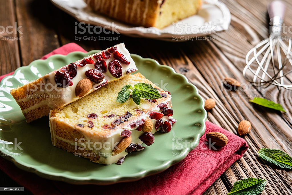 Fruit loaf with cranberries, almond and white chocolate topping stock photo