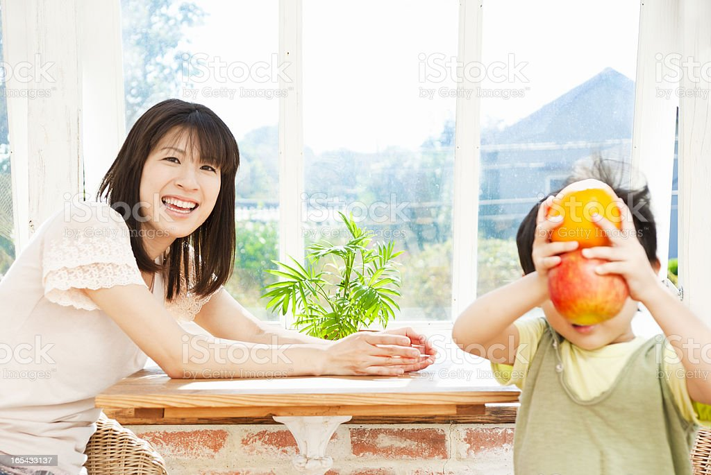 Fruit lover - Asian family stock photo