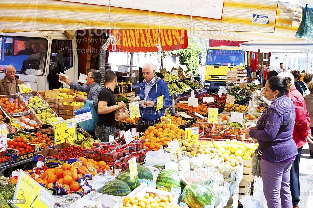 Fruit market stall and Italian vendors royalty-free stock photo