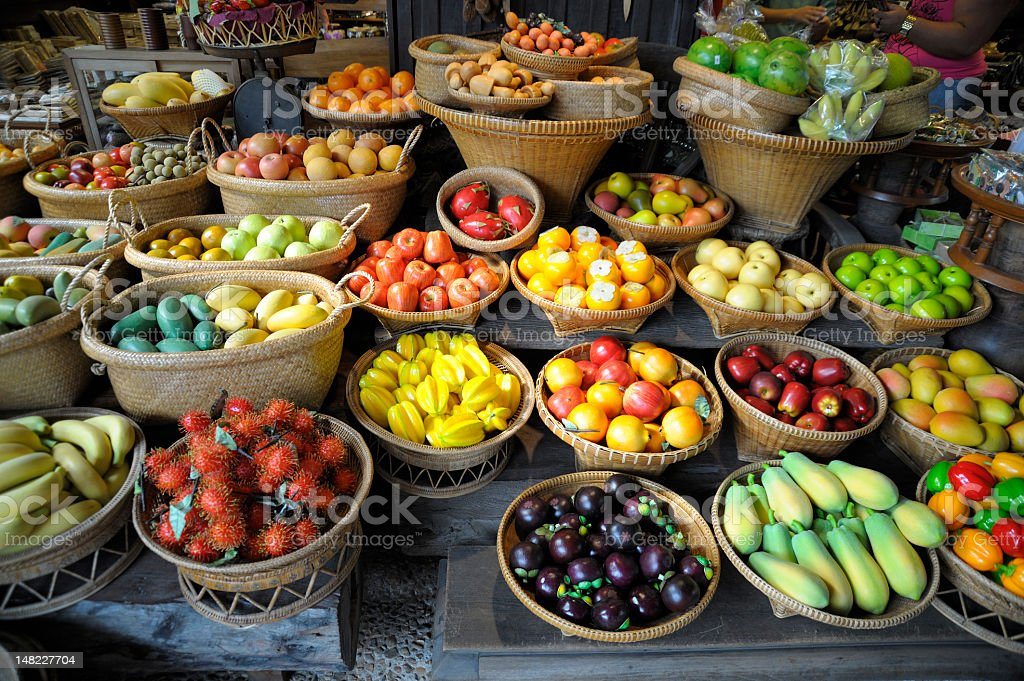 A fruit market with many different types of fruits royalty-free stock photo