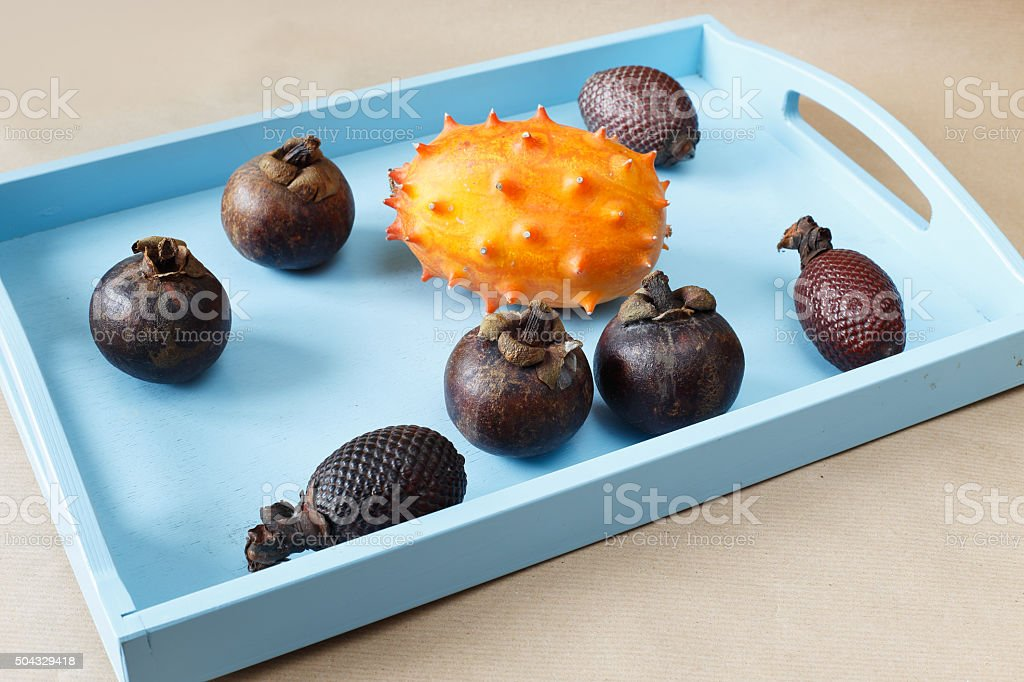 Fruit on a blue tray stock photo