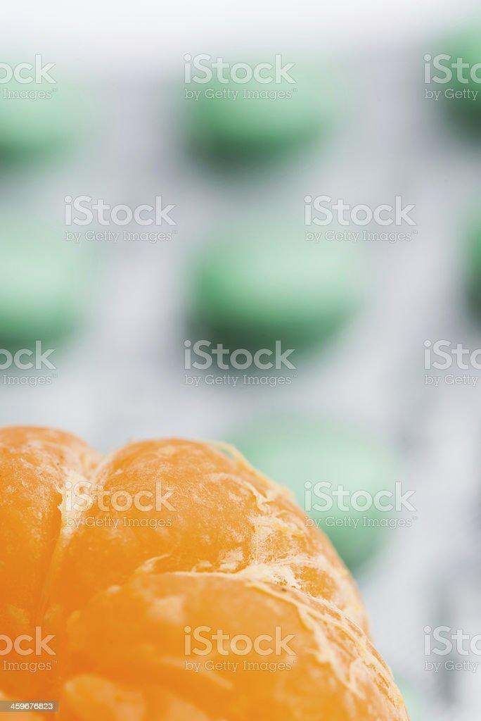 fruit orange and vitamin c pills royalty-free stock photo