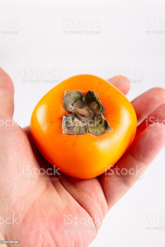Owoce Kaki w mans rękę zbiór zdjęć royalty-free