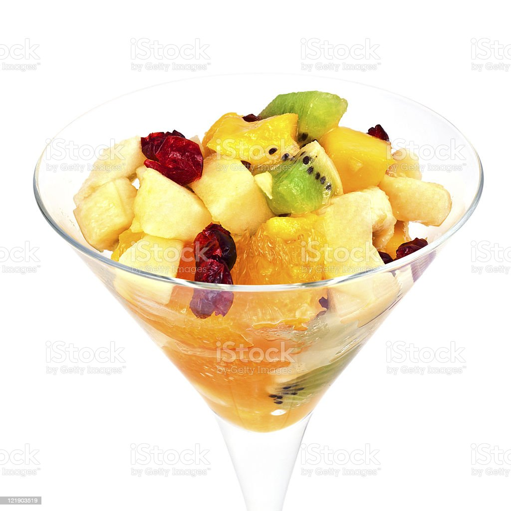 Fruit salad in martini glass isolated on white background royalty-free stock photo