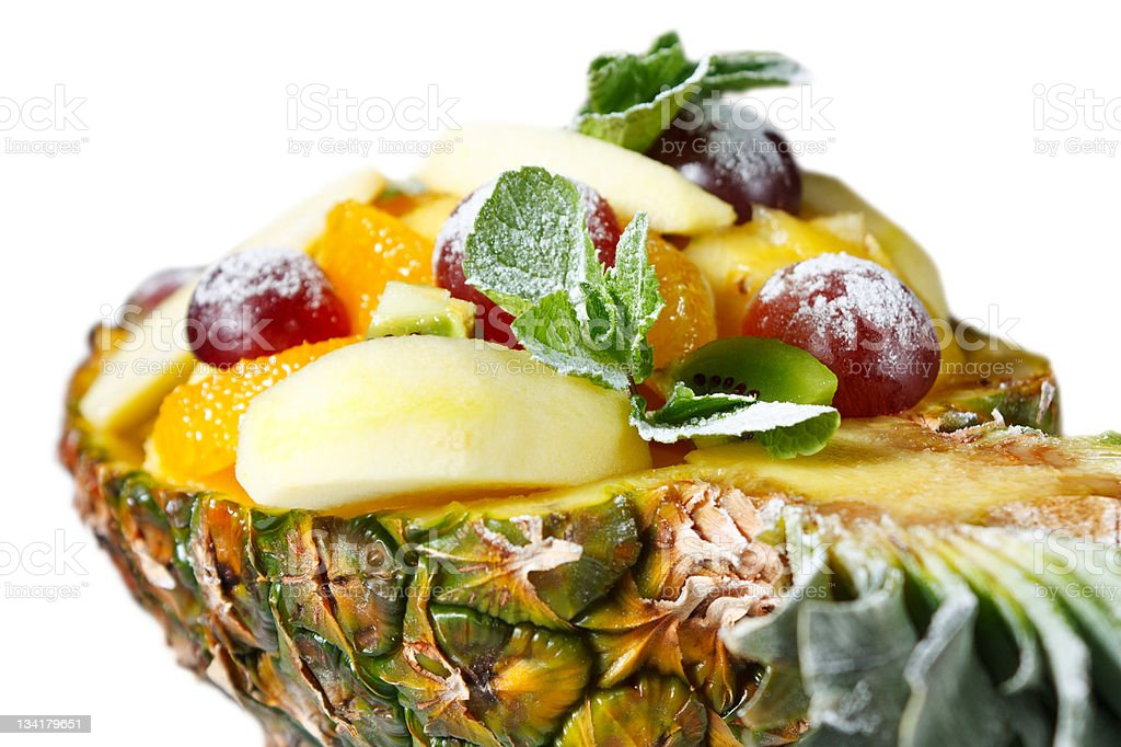 Fruit salad in pineapple stock photo