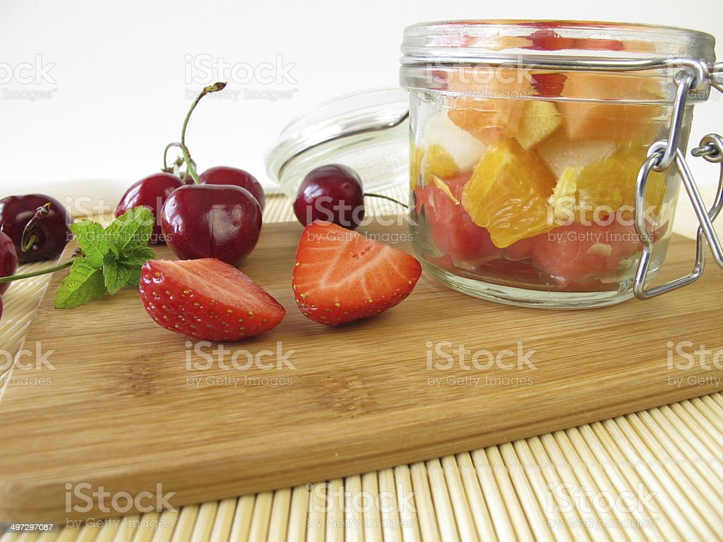Fruit salad in the glass for takeaway stock photo