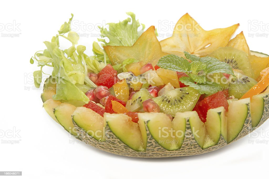 fruit salad in the melon , royalty-free stock photo