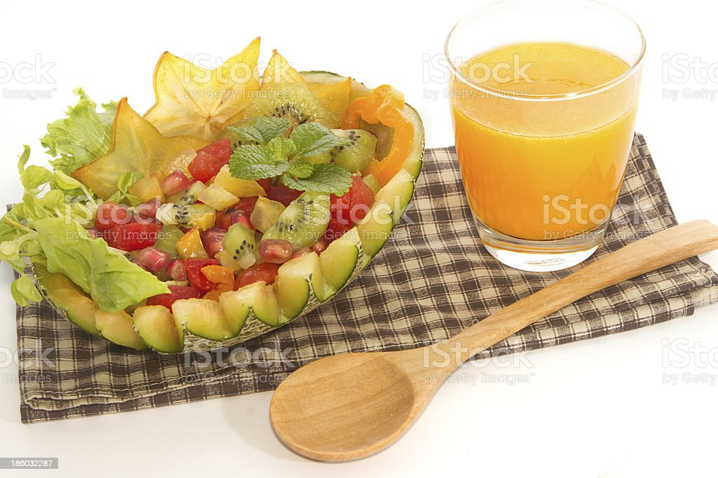 fruit salad in the melon with orange juice royalty-free stock photo