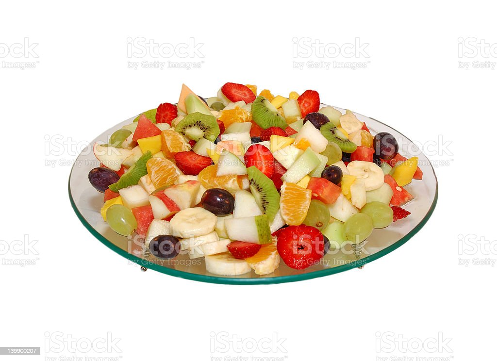Fruit salad on glass plate .  White isolated backround royalty-free stock photo