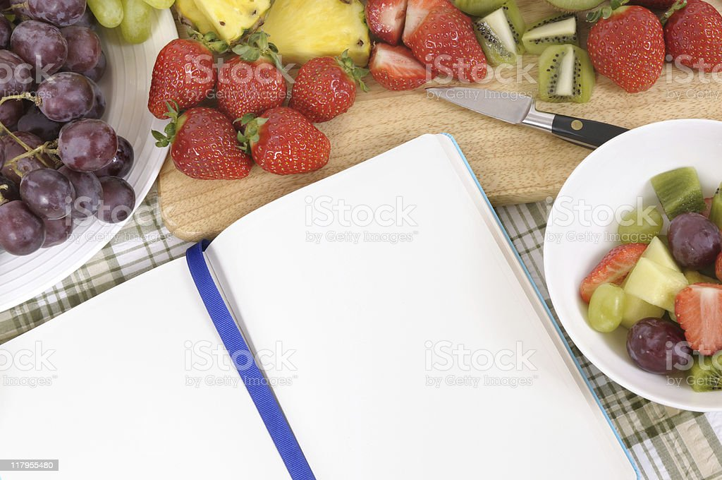 Fruit salad with blue cookbook royalty-free stock photo