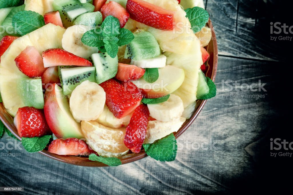 Fruit salad with various fresh and organic fruits stock photo