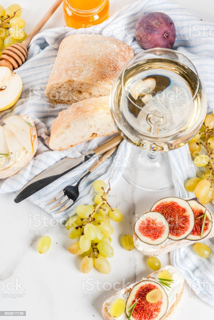 Fruit sandwiches with wine stock photo