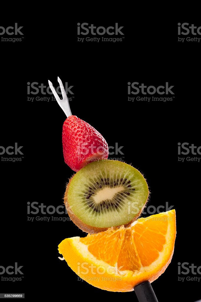 fruit slices in a fondue stock photo