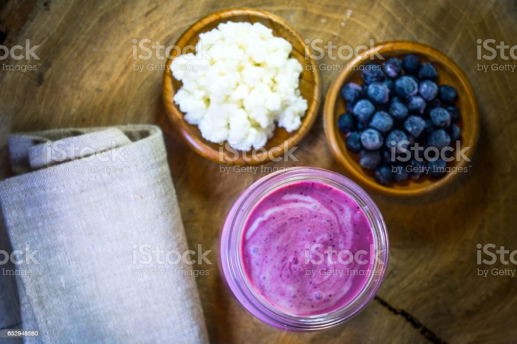 Fruit smoothie made from kefir and aronia berries stock photo