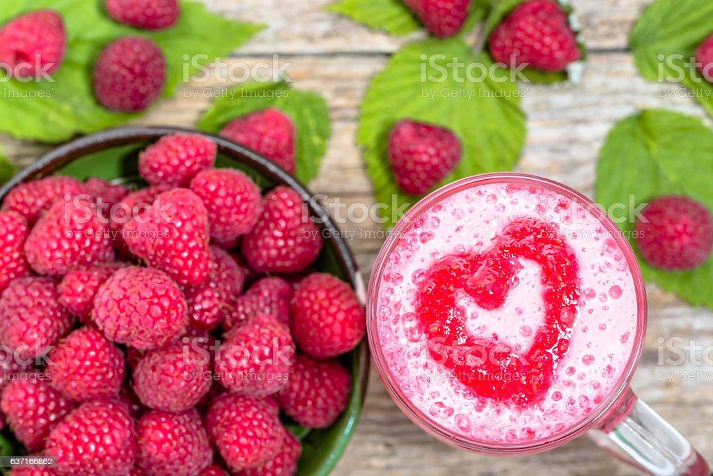 Fruit smoothie with milk and raspberries, milkshake with foam stock photo