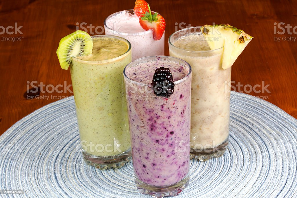 Fruit smoothies on wooden table stock photo