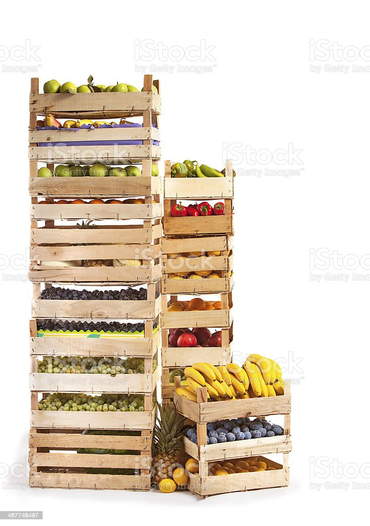 Fruit stored in wooden crates on white background royalty-free stock photo