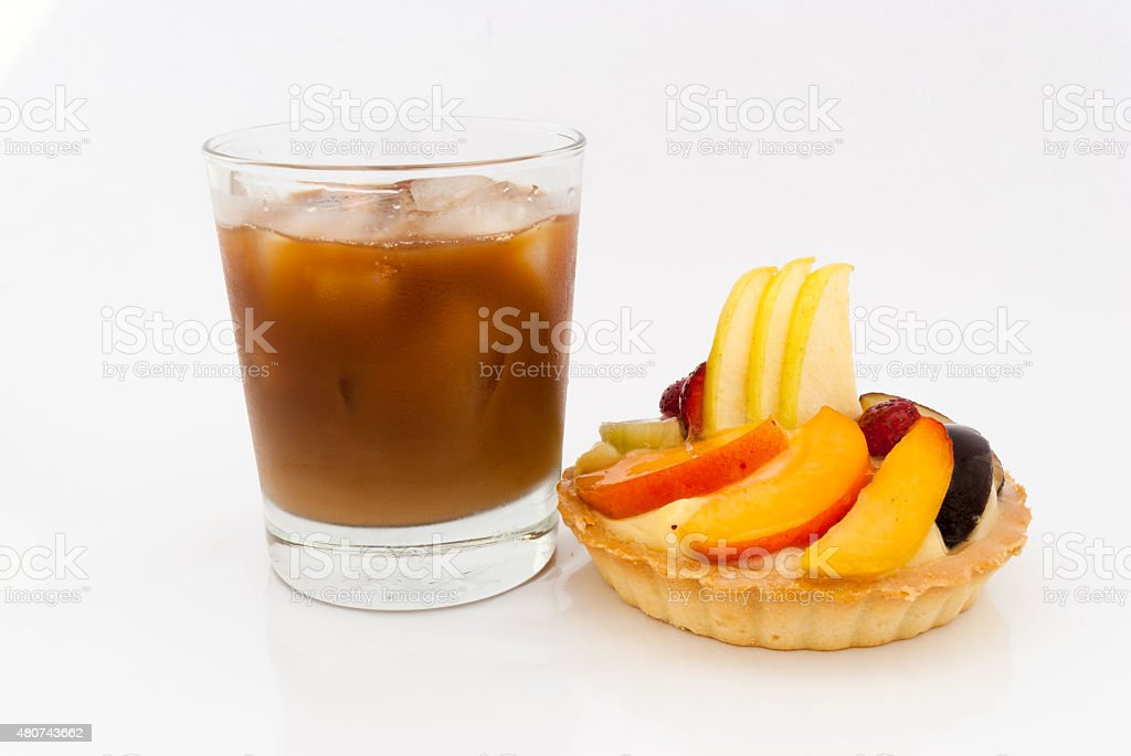 Fruit tart with glass of ice coffee on white background stock photo