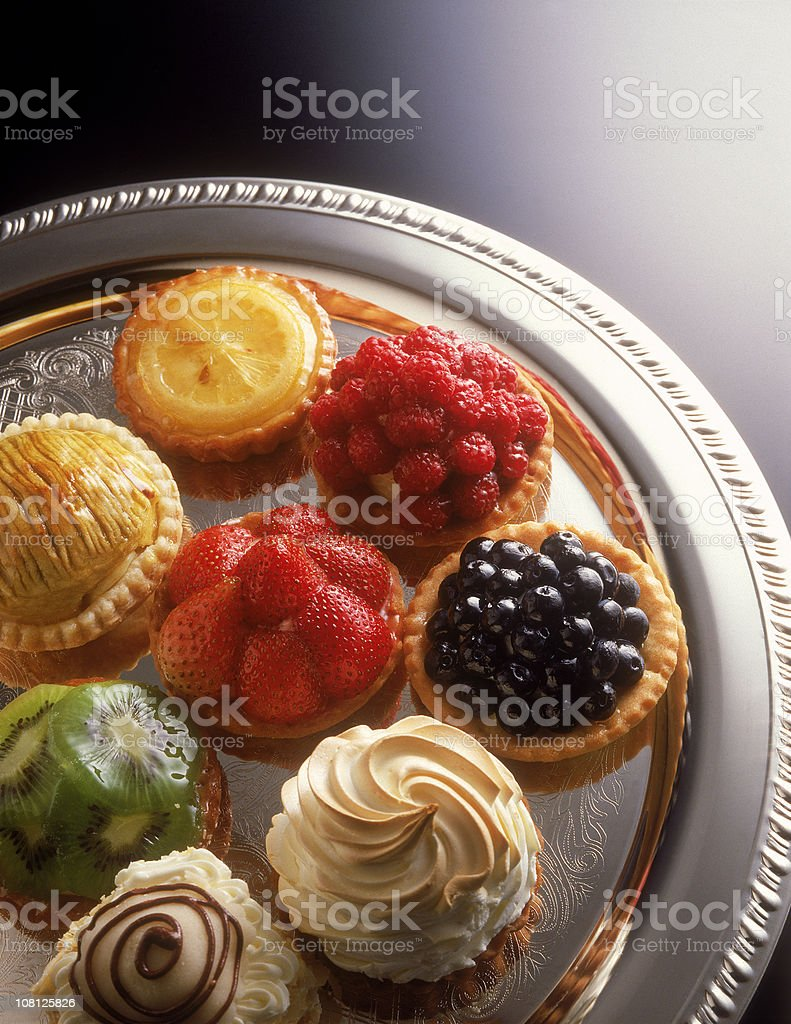 Fruit tarts on a silver serving tray stock photo