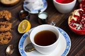 Fruit tea with lemon, milk,honey,orange, pomegranate, on  woode