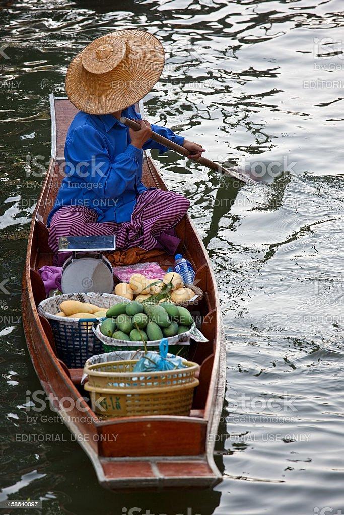 Fruit vendor at Damnoen Saduak Floating Market, Thailand. royalty-free stock photo