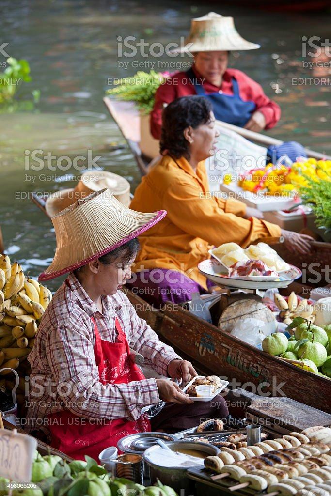 Fruit vendors at Damnoen Saduak Floating Market, Thailand. royalty-free stock photo