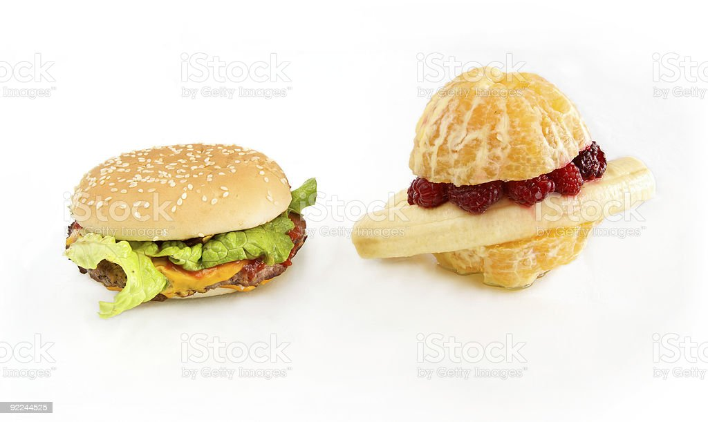 Fruit-  vs cheese- burger stock photo
