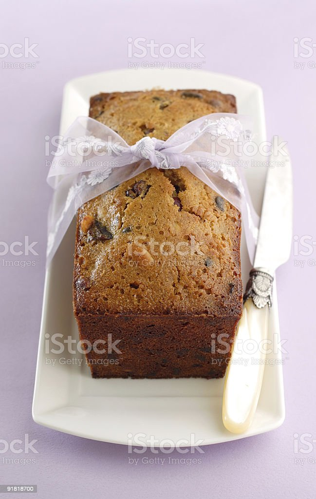 fruitcake loaf on lavender background royalty-free stock photo