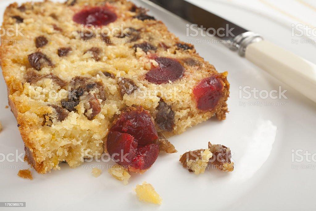 Fruitcake Slice of Coconut Fruit Cake stock photo