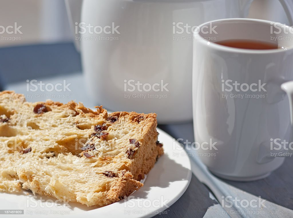 Fruitcake with a cup of tea royalty-free stock photo