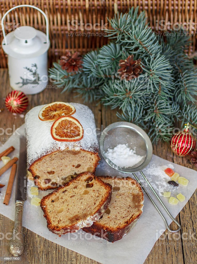 Fruitcake with nuts, raisins, candied fruit and spices stock photo