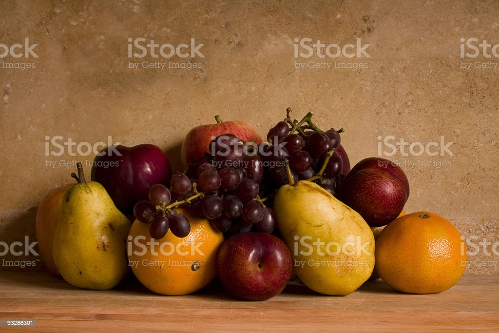 Fruits against a Rustic Wall royalty-free stock photo