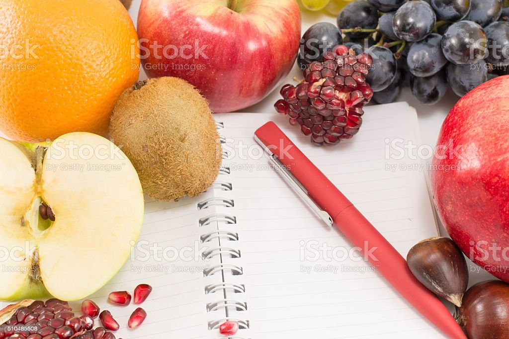 fruits and a notebook stock photo