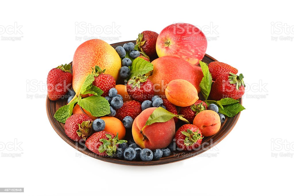 Fruits and berries mix in ceramic plate isolated on white royalty-free stock photo