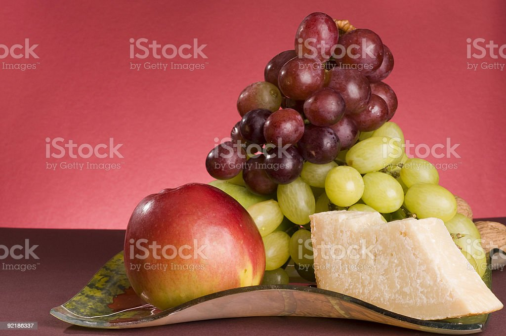 Fruits and cheese lying in a plate. royalty-free stock photo